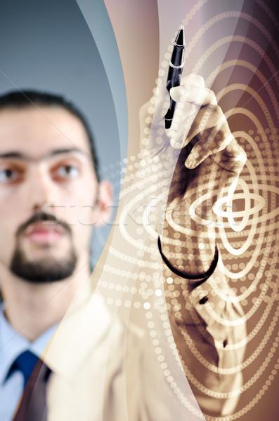 üzletember kisajtolás virtuális gombok futurisztikus számítógép Stock fotó © Elnur