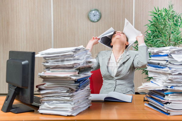Woman under stress from excessive paper work Stock photo © Elnur