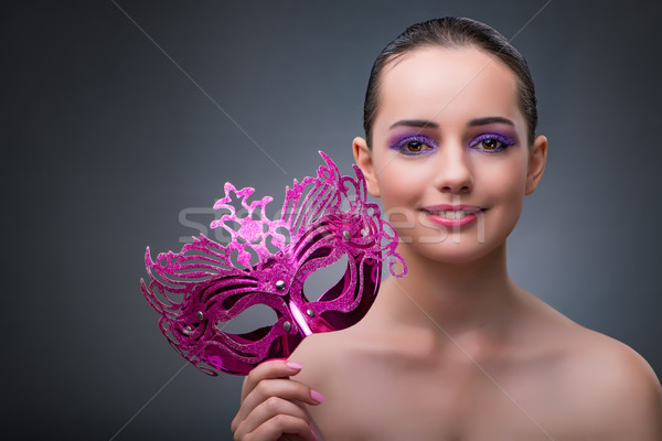 The young woman with carnival mask Stock photo © Elnur