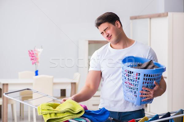 Hombre lavandería casa trabajo triste ropa Foto stock © Elnur