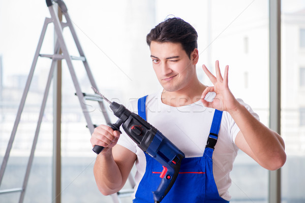 The young worker with hand drill Stock photo © Elnur