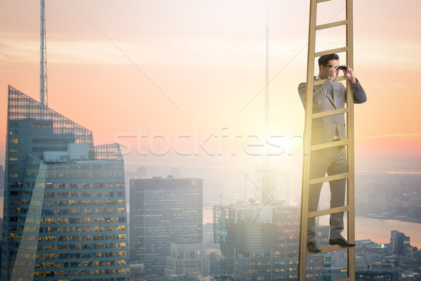 Businessman with binoculars looking into future Stock photo © Elnur