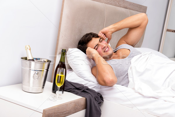 Man having hangover after night party Stock photo © Elnur