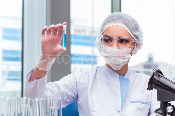 Young student working with chemical solutions in lab Stock photo © Elnur