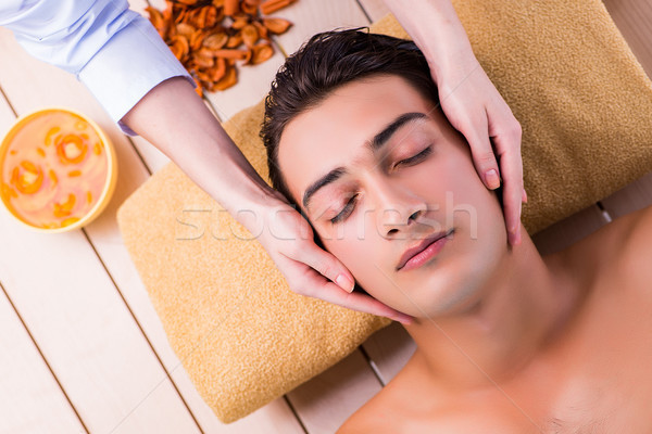 Man during massage session in spa salon Stock photo © Elnur