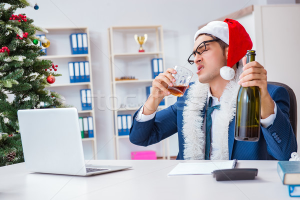 Businessman celebrating christmas holiday in the office Stock photo © Elnur