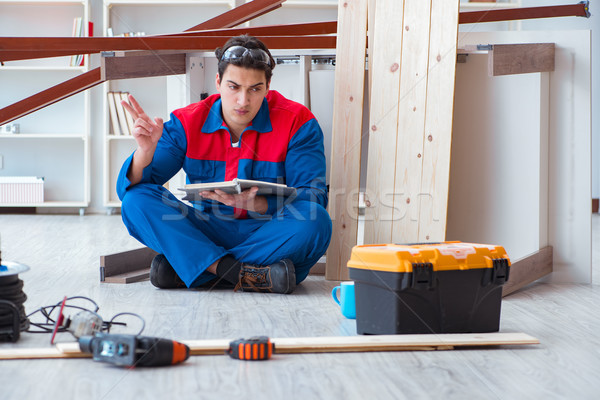 Young carpenter with notebook writing planning at construction r Stock photo © Elnur