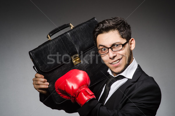 Businessman with boxing gloves in sport concept Stock photo © Elnur