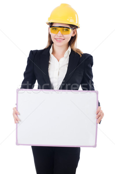 Pretty businesswoman with hard hat and blank board   isolated on Stock photo © Elnur