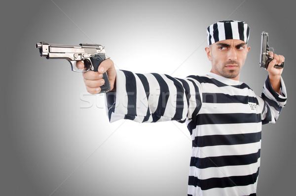 Prisioneiro pistola isolado branco mão segurança Foto stock © Elnur