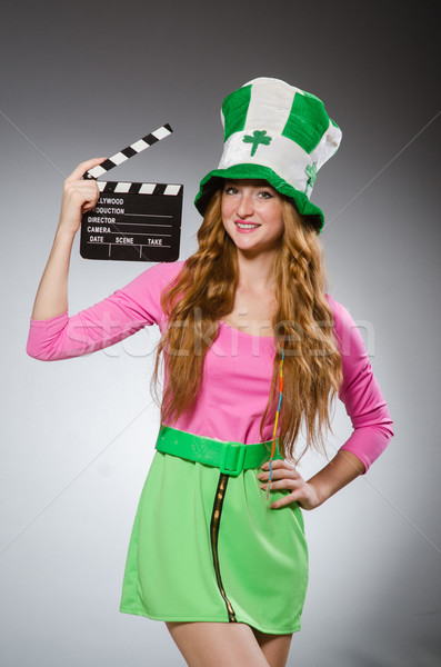 Woman with movie board in saint patrick concept Stock photo © Elnur