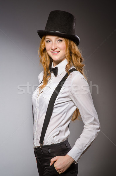 Pretty girl wearing retro hat isolated on gray Stock photo © Elnur