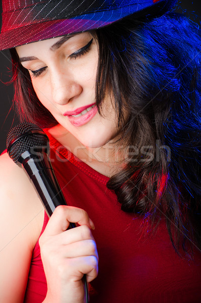 Mujer cantando karaoke club fiesta pelo Foto stock © Elnur