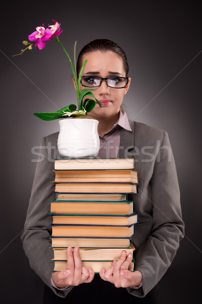 Young student with books and clock Stock photo © Elnur