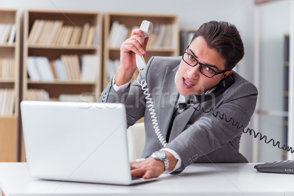 Angry helpdesk operator in the office Stock photo © Elnur