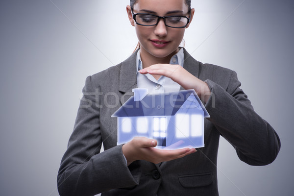 Businesswoman in real estate mortgage concept  Stock photo © Elnur