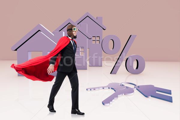 Superhero man in mortgage concept Stock photo © Elnur
