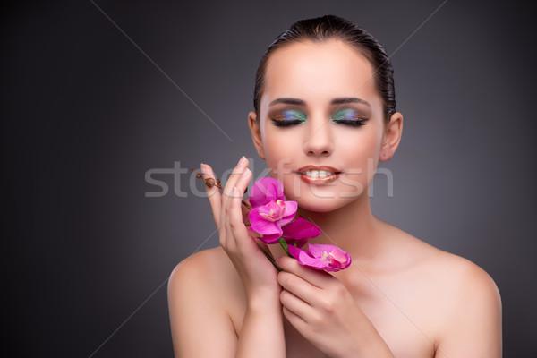 Bella donna orchidea fiore donna fiori sorriso Foto d'archivio © Elnur