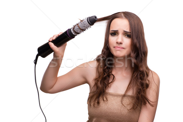 Young beautiful woman with hair dryer isolated on white Stock photo © Elnur
