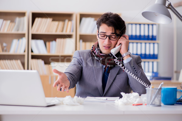 Sick businessman suffering from illness in the office Stock photo © Elnur