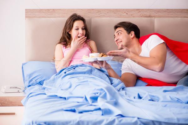 Szuperhős férj ágy nő étel férfi Stock fotó © Elnur
