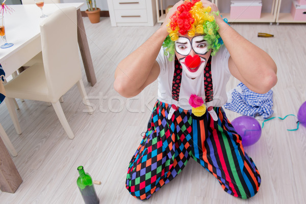 Drunk clown celebrating having a party at home Stock photo © Elnur