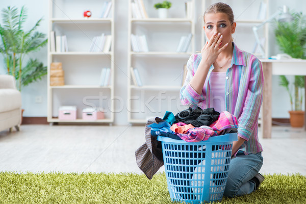 Tired depressed housewife doing laundry Stock photo © Elnur