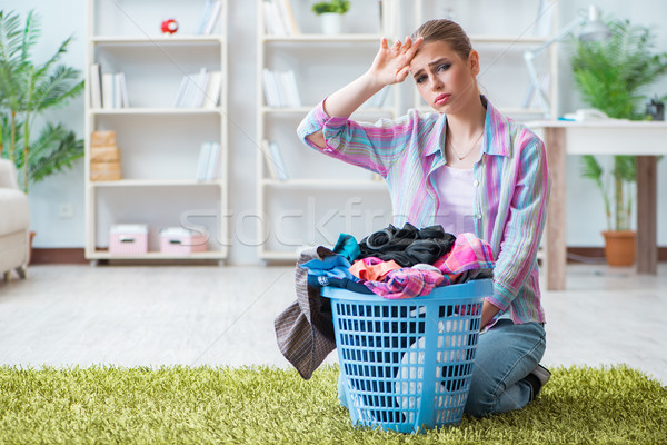 Stock photo: Tired depressed housewife doing laundry
