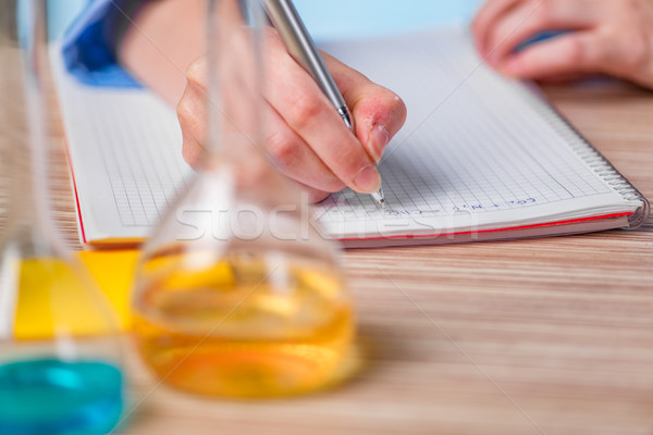Experienced lab assistant working on chemical solutions Stock photo © Elnur