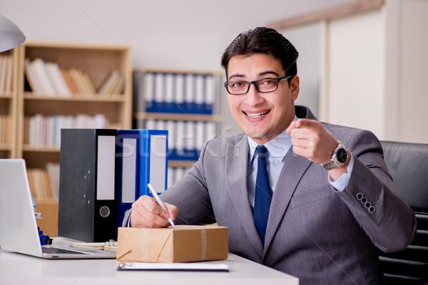 Businessman receiving parcel in office Stock photo © Elnur