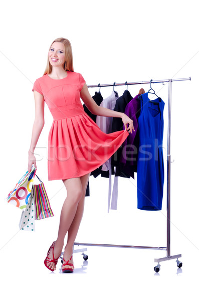 Woman trying new clothing on white Stock photo © Elnur