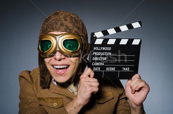 Vicces pilóta védőszemüveg sisak férfi film Stock fotó © Elnur