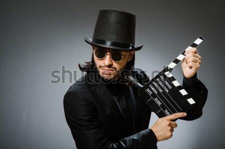 Férfi fegyver klasszikus kalap üzlet kéz Stock fotó © Elnur