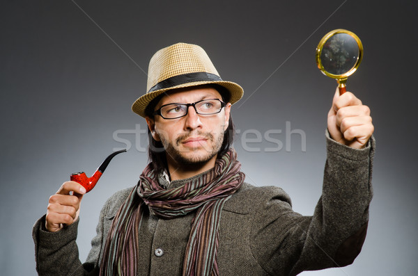 Funny detective with smoking pipe and magnifying glass Stock photo © Elnur