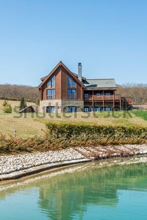 Modern house near water on bright day Stock photo © Elnur