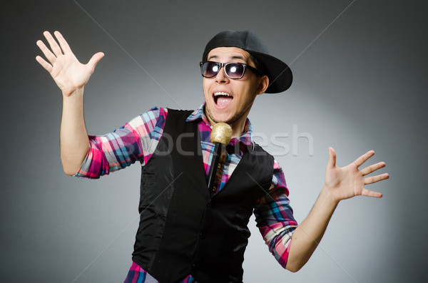 Stock photo: Funny man singing in karaoke
