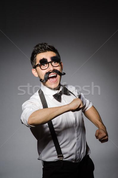 Jonge man vals snor geïsoleerd grijs man Stockfoto © Elnur