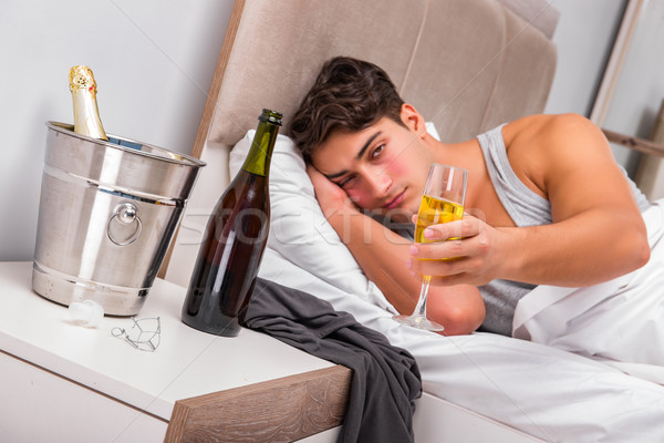 The man in the bed after party - hangover concept Stock photo © Elnur