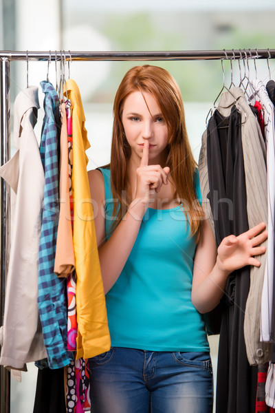 Woman choosing clothing in shop Stock photo © Elnur