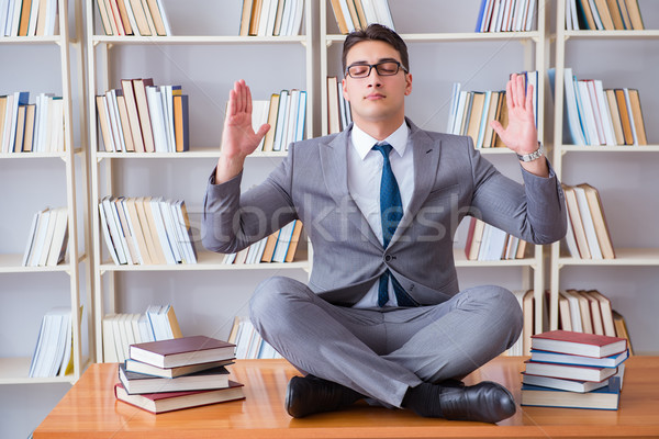 Businessman student in lotus position concentrating meditating   Stock photo © Elnur