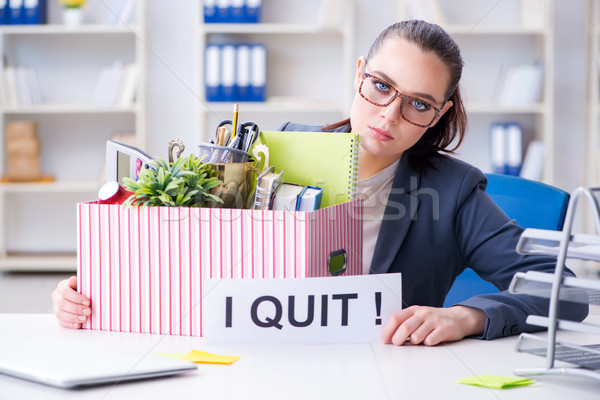 Businesswoman resigning from her job Stock photo © Elnur