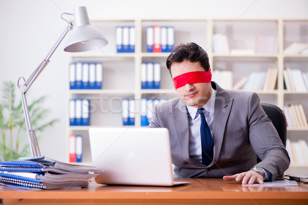 The blindfold businessman sitting at desk in office Stock photo © Elnur