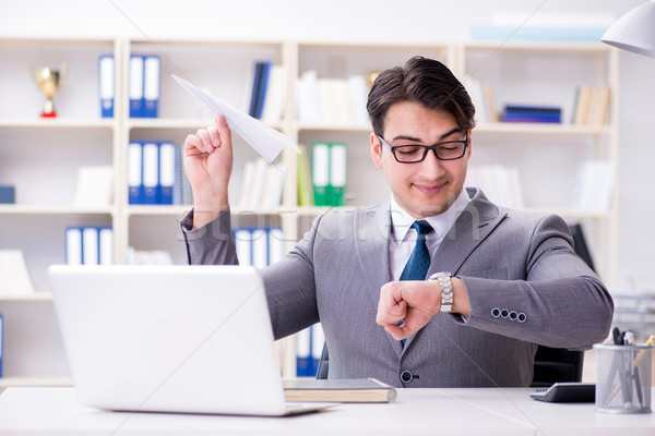 Businessman with paper airplane in office Stock photo © Elnur