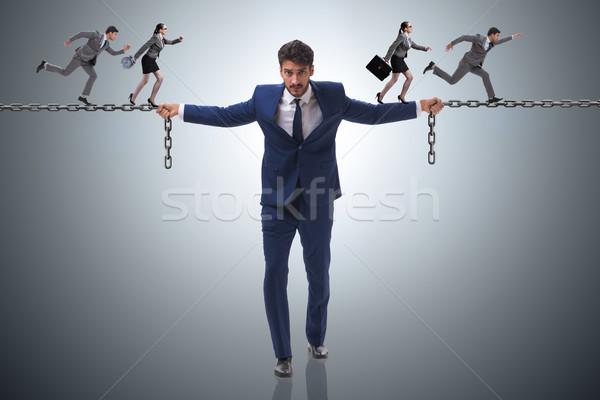 Businessman providing help to colleagues Stock photo © Elnur