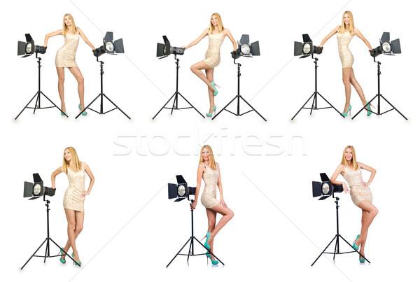 Woman during photo photosession on white Stock photo © Elnur