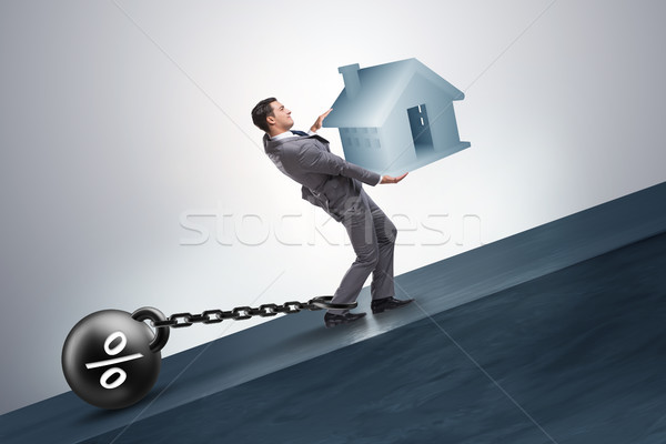 Businessman in mortgage debt financing concept Stock photo © Elnur