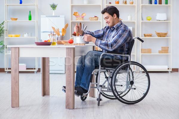 Niepełnosprawnych człowiek zupa kuchnia krzesło kucharz Zdjęcia stock © Elnur