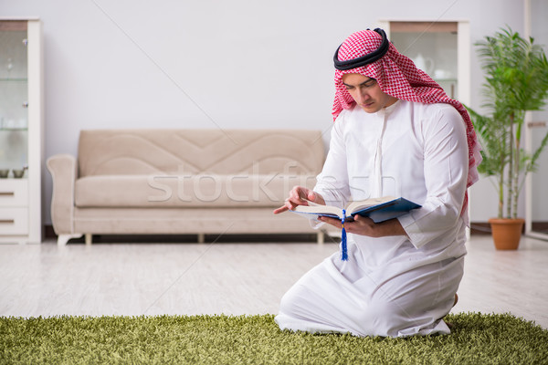 Arab man praying at home Stock photo © Elnur