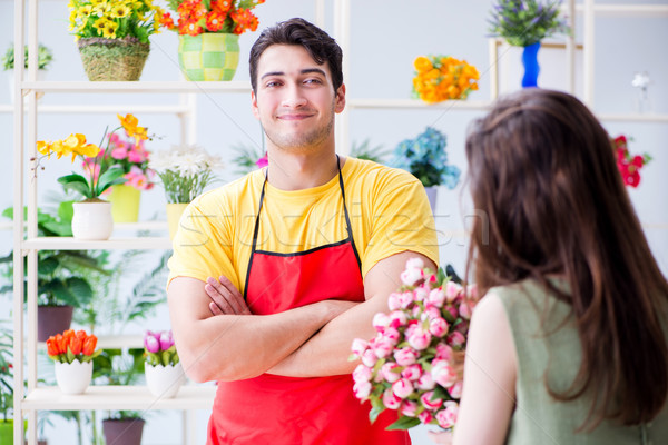 Florist selling flowers in a flower shop Stock photo © Elnur