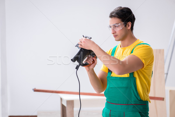 The contractor working on laminate wooden floor Stock photo © Elnur
